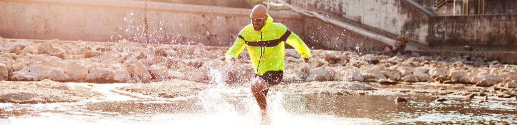 Man running in river